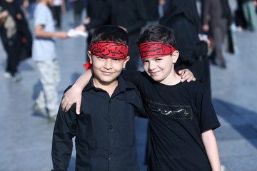 Boys pose for a photograph as they commemorate the Arbaeen in Tehran