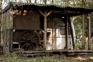 An old abandoned caravan trailer in the woods.