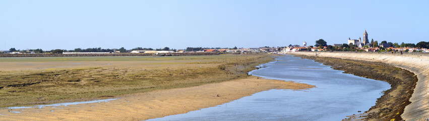 panoramic view of the entrance of the port and the Jacobsen pier of the village of Noirmoutier, on the Atlantic coast in western France