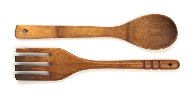 Wooden Spoon and fork isolated on a white background.