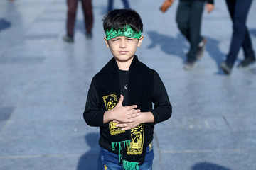 A boy poses for a photograph as during commemorations of the Arbaeen in Tehran