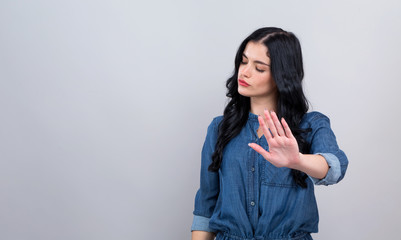 Obraz Young woman making a rejection pose on a gray background - fototapety do salonu