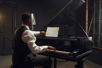 Ebony pianist, jazz performer on the stage