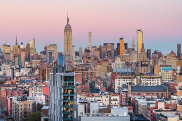 New York City midtown Manhattan financial buidings city skyline at dusk.