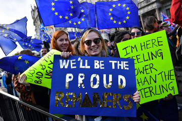 EU supporters, calling on the government to give Britons a vote on the final Brexit deal, attend a 'People's Vote' march in London