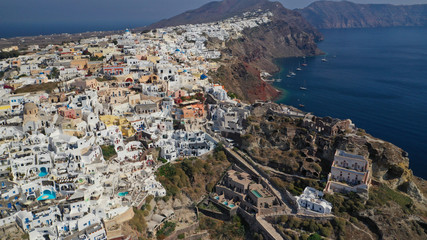 Aerial drone photo of traditional and picturesque village of Oia in volcanic island of Santorini, Cyclades, Greece