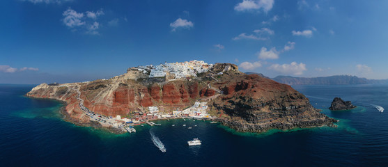 Aluminium Prints Santorini Aerial drone panoramic photo of traditional and picturesque village of Oia in volcanic island of Santorini, Cyclades, Greece