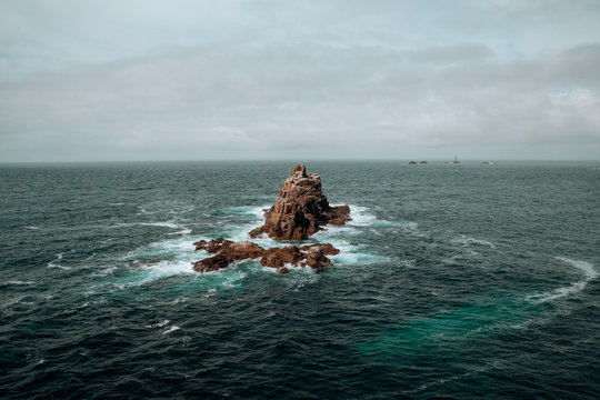 rock in the middle of the ocean