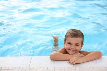 Cute little boy in outdoor swimming pool