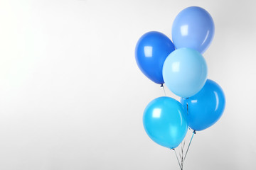 Bunch of blue balloons on white background. Greeting card