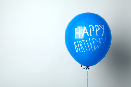 Blue balloon with words HAPPY BIRTHDAY on white background