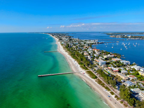Aerial view of Cortez beach withe sand beach and his little wood pier on blue water, Anna Maria Island, Florida, USA