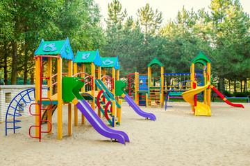 Colorful children playground activities in public park. Safe modern children's playground