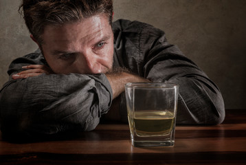 Foto auf Leinwand Bar desperate alcoholic man . depressed addict isolated in front of whiskey glass trying not drinking in dramatic expression suffering alcoholism and alcohol addiction problem