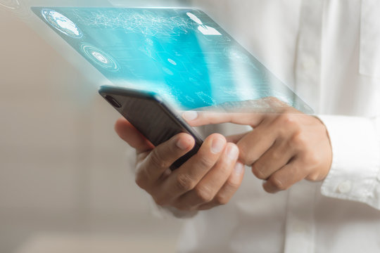 Business people use their smartphones to connect to data communications around the world.