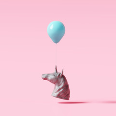 Concrete unicorn statue with blue balloon on pastel pink background. Creative idea. Minimal concept. 3d rendering