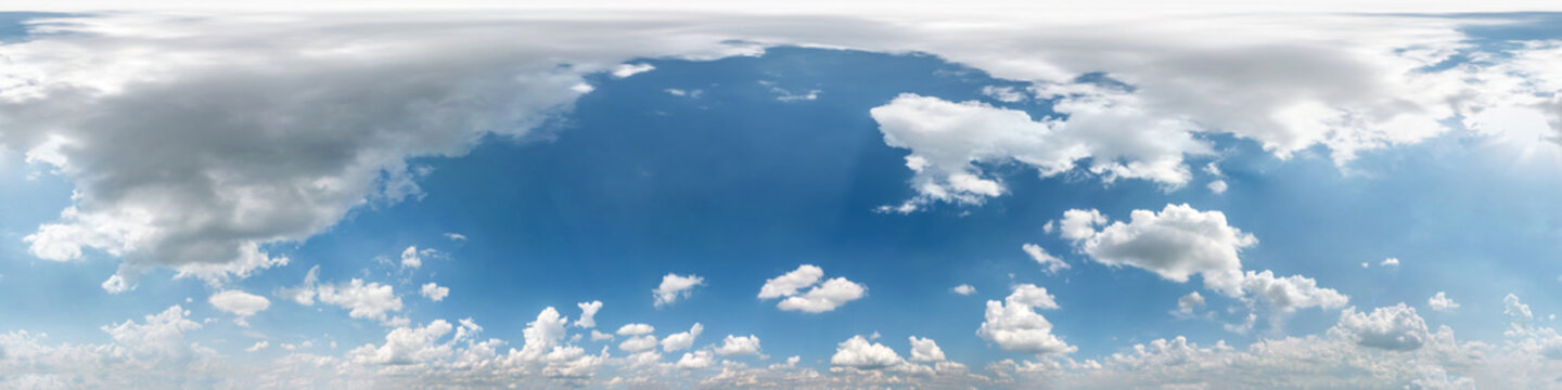 Seamless cloudy blue sky hdri panorama 360 degrees angle view with beautiful clouds  with zenith for use in 3d graphics as sky dome or edit drone shot