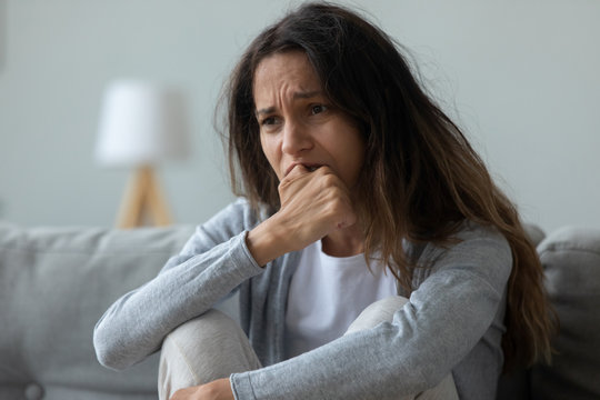 Frustrated young mixed race girl feeling desperately.