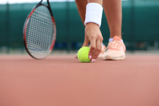 Tennis racket and the ball on tennis court.