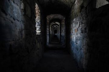 darkness underground passage in cold medieval castle dungeon