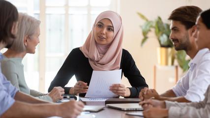 Asian muslim businesswoman executive wear hijab leading corporate briefing