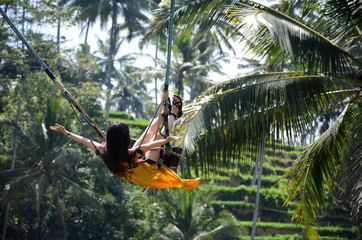 Fotorolgordijn Bali Young woman swinging in the jungle rainforest of Bali, Indonesia