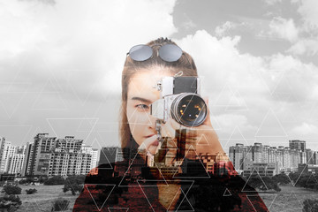 asian woman photographer with old camera in city abstract background
