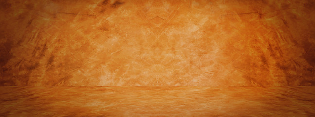 Horizontal yellow and orange grunge texture cement or concrete wall banner, blank studio background