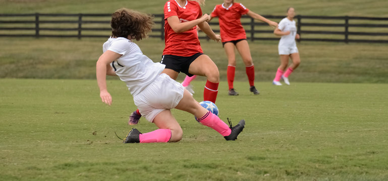 Teenage Girl Tackles During Soccer Game