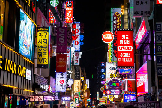 SEOUL, SOUTH KOREA – SEPTEMBER 8 2019: Illuminated signboards at stores in Jongno District offering food, drinks and entertainment. This street is Ujeongguk Ro 2 Gil.
