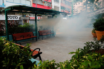 A cloud of tear gas is seen at the park during an anti-government protest in Hong Kong