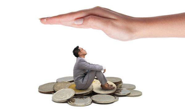Hand protect business man sitting on coins