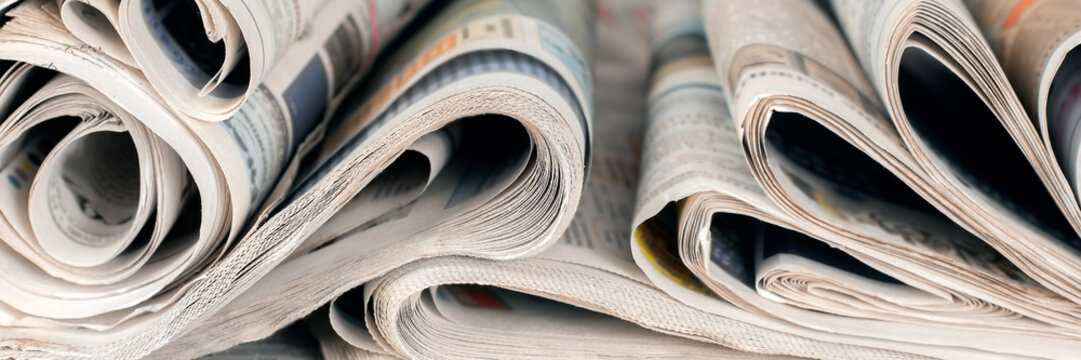 Newspapers, world news information concept, close-up, panoramic
