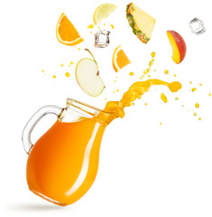 Wall Mural - fruit slices falling into a pitcher of splashing juice on white bacground