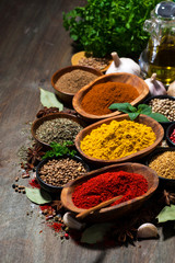 Canvas Prints Spices assortment of oriental spices on a wooden background, vertical