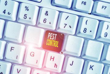 Handwriting text Pest Control. Conceptual photo Killing destructive insects that attacks crops and livestock White pc keyboard with empty note paper above white background key copy space