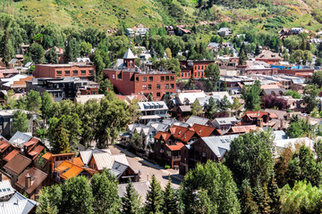 Telluride, Colorado small town with aerial high angle bird's eye view of city cityscape from free gondola to mountain village in summer