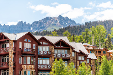 Fototapeta Telluride, Colorado small town Mountain Village in summer 2019 with view of San Juan Mountains and modern resort lodge apartment condo architecture