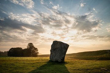 Printed kitchen splashbacks Beige Stunning Summer sunrise landscape of Neolithic standing stones in English cluntryside with gorgeous light with slight background mist