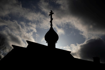 A dome of a wooden church is seen in the fortress of the town of Staraya Ladoga