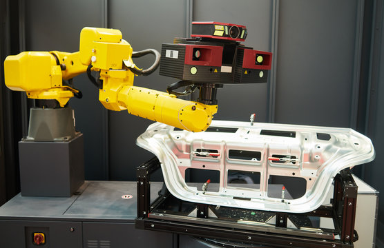 Robotic industry. Robot with 3D sensor scanner measures surface of detail in automotive industry