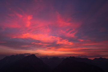 Poster Crimson burning red sky in the alps