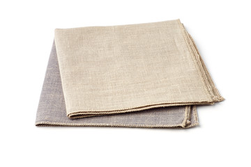 Beige and gray textile napkins on white background