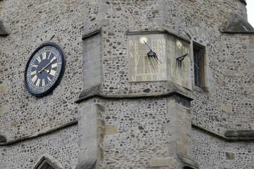 Historic clock and sundial in Cambridge