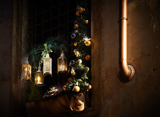Decorative golden Christmas decoration lights on the wall