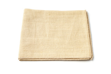Beige textile napkin on white background