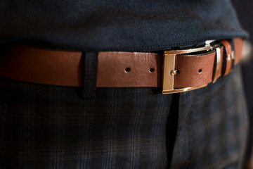 Brown leather men 's belt in trousers