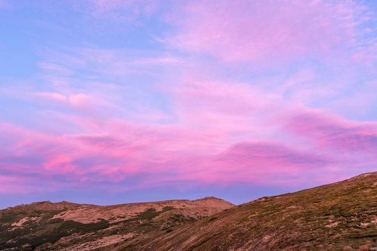 Unusually beautiful sky in the mountains. Beautiful purple sky.