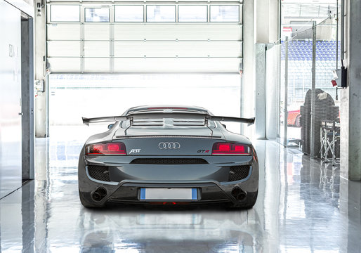 Spielberg, Styria / Austria - August 15 2019 : Back view of special edition of Audi ABT R8 GTR in the garage.