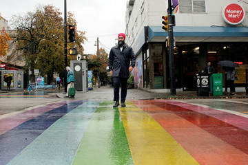 New Democratic Party (NDP) leader Jagmeet Singh crosses a rainbow sidewalk during an election campaign visit in Vancouver